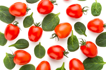 Spinach and tomato pattern background on white. Top view