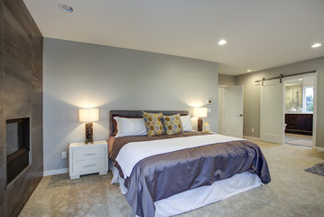 Upstairs stunning master bedroom with fireplace and private deck