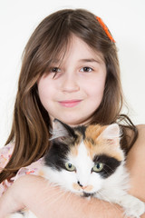 Girl with a cat in her arms smiling happy