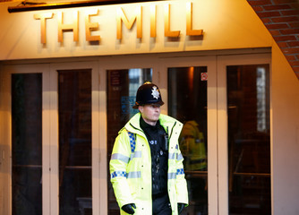 A police officer stands on duty outside a pub which has been secured as part of the investigation into the poisoning of former Russian intelligence agent Sergei Skripal and his daughter Yulia, in Salisbury
