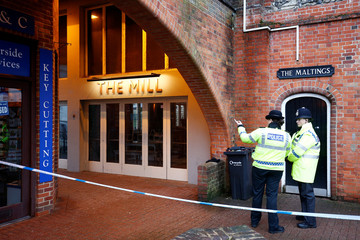 Police officers stand on duty outside a pub which has been secured as part of the investigation into the poisoning of former Russian intelligence agent Sergei Skripal and his daughter Yulia