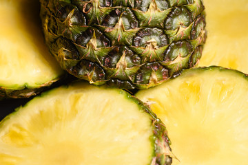 Close-up juicy cut pineapple on the kitchen table