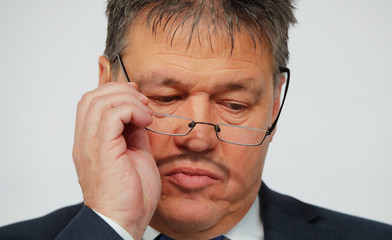 Innogy SE CEO Tigges adjusts his glasses during the company's news conference in Essen