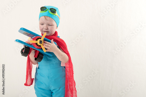 Funny boy in blue overalls and hat wearing a red scarf and glasses for swimming  sc 1 st  Fotolia & Funny boy in blue overalls and hat wearing a red scarf and glasses ...