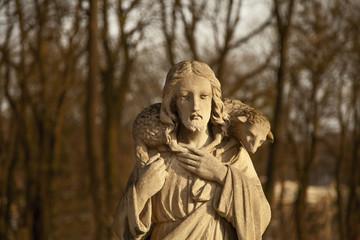 Ancient statue of Jesus Christ Good Shepherd (faith, religion, Christianity, God concept)