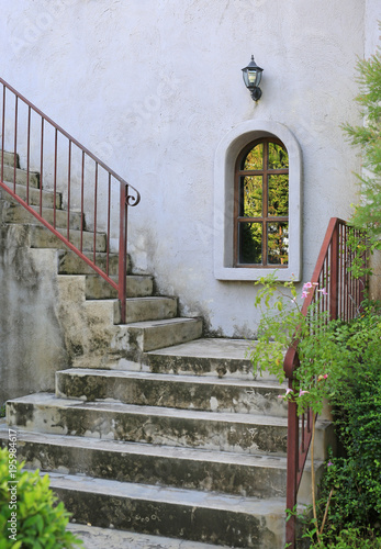 Outside Vintage Stair With Metal Railing. Construction Is Grunge And Rusty  Touching.