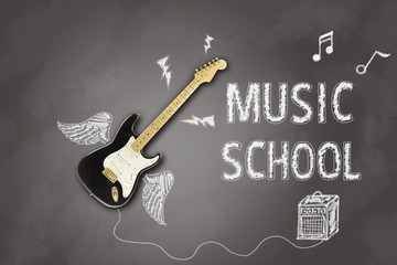 announcement with electric guitar on blackboard for lessons of a music school / mage depicting an electric guitar on a blackboard with announcement written in chalk related to music lessons