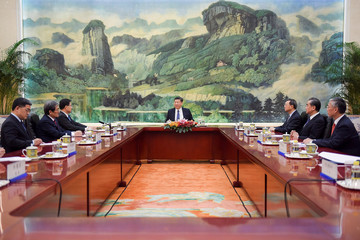 Chinese President Xi Jinping attends a meeting at the Great Hall of The People in Beijing
