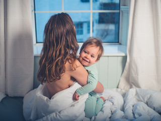 Mother embracing little boy in morning
