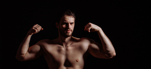horizontal photo of bodybuilder with a thick naked body.personal fitness trainer. strong muscles