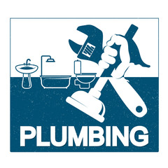 Plumbing repair with a wrench in his hand