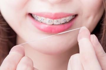 woman take dental floss