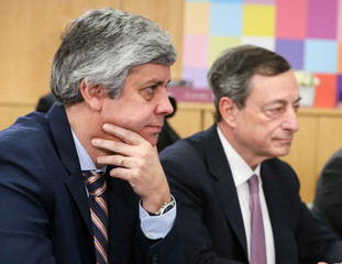 Portugal's Finance Minister and Eurogroup President Centeno and ECB President Draghi attend a meeting with EU Council President Tusk at the EU Council headquarters in Brussels