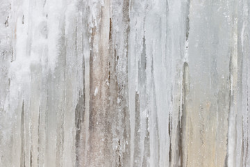 Frozen waterfall background. Wall texture from big icicles