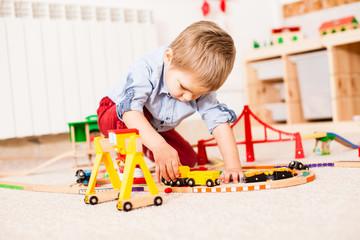 Boy plays with train