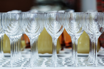 Empty wine glasses on stand on the table