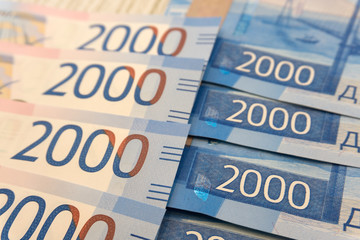 background of the new banknotes worth 2000 rubles .