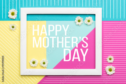 Happy Mother's Day Pastel Coloured Background. Floral flat lay minimalism greeting card.