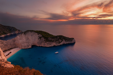 Ship Wreck beach and Navagio bay at sunset. The most famous natural landmark of Zakynthos, Greek island in the Ionian Sea.