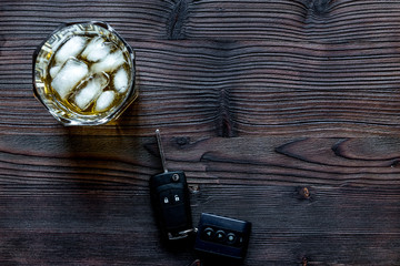 concept of alcohol and driving on wooden background top view