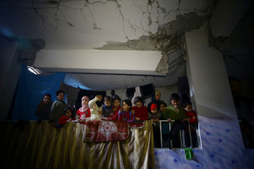 Children are seen in a shelter in the besieged town of Douma