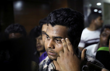 Shawon, a relative of a passenger who was on board of crashed aircraft of US-Bangla Airlines, visits airline office in Dhaka