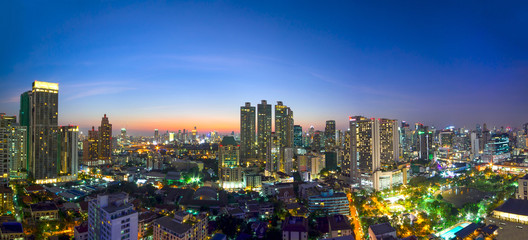 modern office buildings and condominium in Bangkok city downtown with sunset sky and clouds at Bangkok , Thailand.