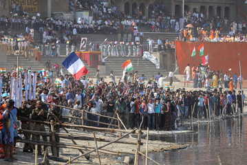 Crowd waits for the arrival of French President Emmanuel Macron and Indian Prime Minister Narendra Modi in Varanasi,