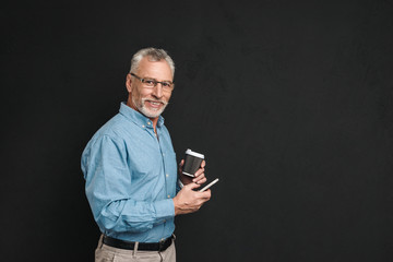 Portrait of a happy mature man dressed in shirt
