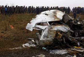 A cockpit of a crashed US-Bangla airplane lies on the crash site at the Tribhuvan International Airport in Kathmandu