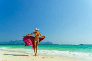 Woman at the beach in Koh Poda island Thailand
