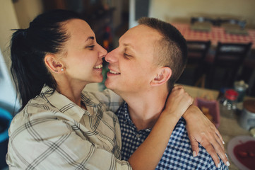 Romantic couple in love spending time together in kitchen