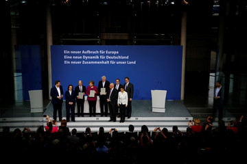 CDU, CSU and SPD sign a coalition deal during a ceremony in Berlin