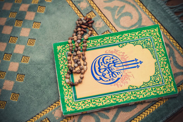 The picture Muslim rosary beads and book