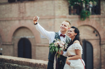 newly wedded couple making selfie after ceremony