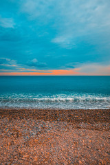 high formated picture of colorful stone beach with cloudy sky