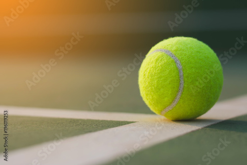 Close Up Tennis Ball On The Courts Background Stock Photo And