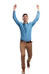 walking casual man celebrting success with hands in the air