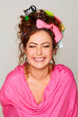 Portrait of young and happy woman with interesting and creative hairstyle