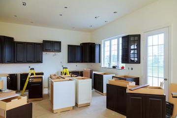 Installing new induction hob in modern kitchen kitchen