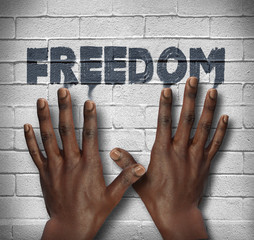 African hands on the wall with text Freedom
