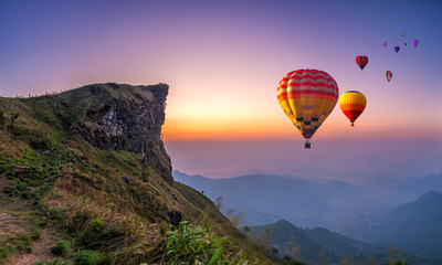 Poster Ballon Colorful hot air balloons flying over mountain at Phu Chi fa National Park in the morning. Chiang Rai Province, Thailand