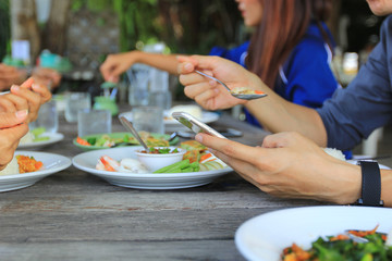 Man hand holding smartphone in restaurant, Communication technology concept