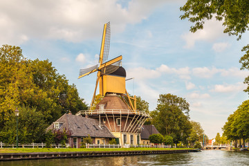 Ancient wooden windmill in the village of Weesp