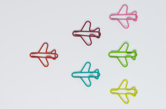 Colorful plane paperclip point to same direction shaped like arrow for business concept of teamwork and team leadership