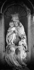 Queen of Heaven. Ancient statue of the Virgin Mary with Jesus Christ (Christianity, religion, faith, God concept)