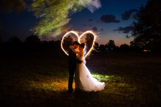 Hispanic Bride and Groom at Night with Light Painting Heart