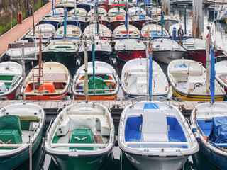 Lot of Сolored boats at the pier