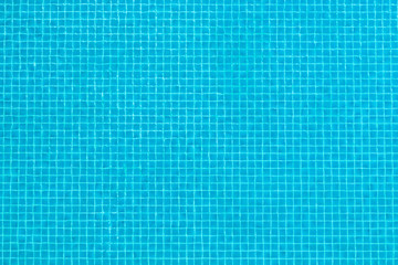 Aerial top view of transparent blue surface swimming pool texture abstract background.