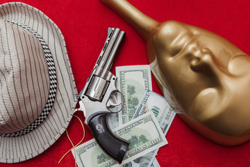 Gun and money with a mask and hat